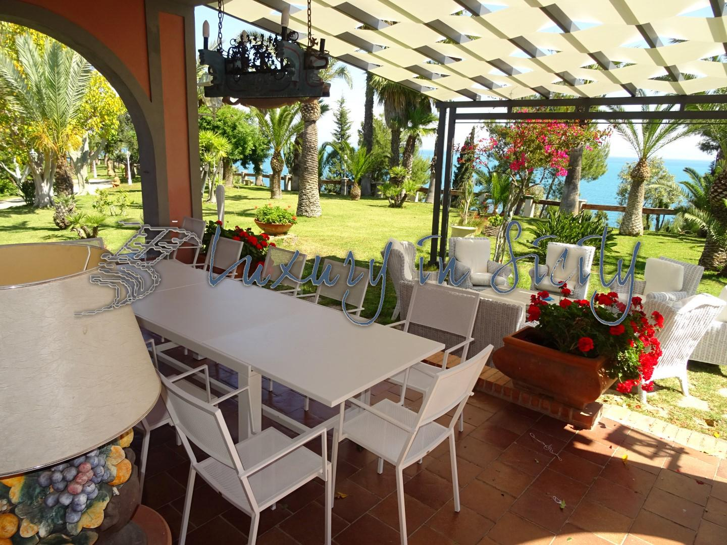 Exclusive seaside villa with private beach and marina